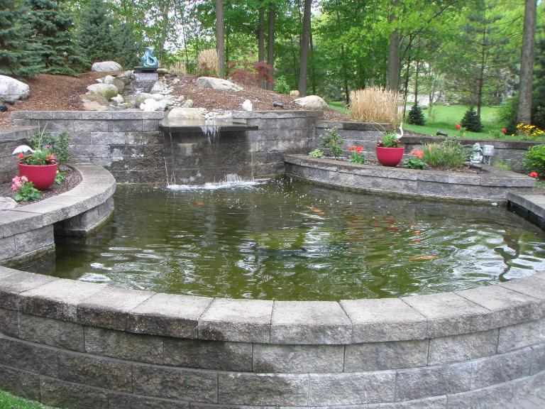 Watercourse and Koi Pond, versa lok and natural stone boulders